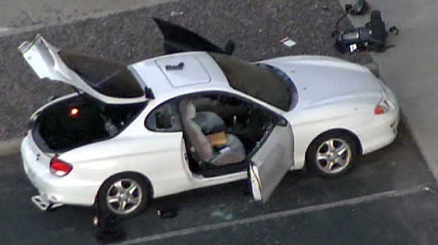 The shooting suspect's damaged car outside the Aurora, Colorado theatre following the shooting, Friday, July 20, 2012. Police said the 24-year-old gunman was armed with three guns: a rifle, a handgun and a third gun.
