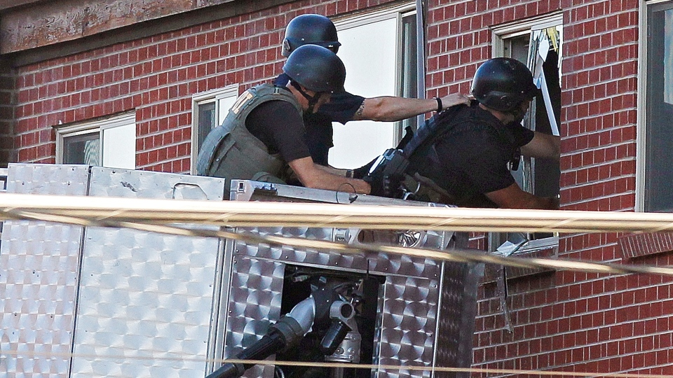 Police use a video camera to look inside an apartment where the suspect in a shooting at a movie theatre lived in Aurora, Colo., Friday, July 20, 2012. (AP / Ed Andrieski)
