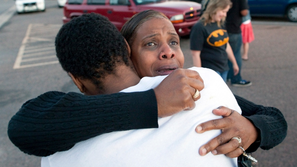 Shamecca Davis hugs her son Isaiah Bow, who was an eye witness to the mass shooting in Denver, Colorado on Friday, July 20, 2012 in Denver. (AP / Barry Gutierrez)