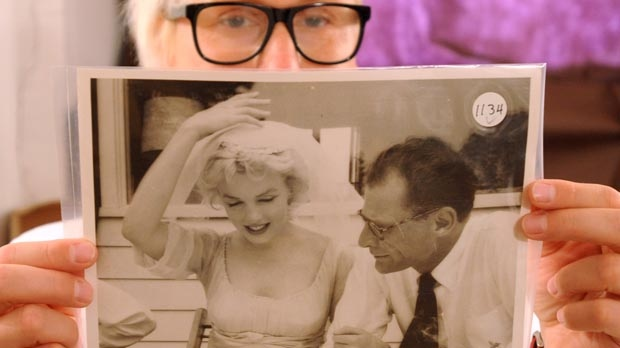 Photo gallery curator Anna Wolska presents a photo of Marylin Monroe and Arthur Miller taken by the late celebrity photographer Milton H. Greene, in Warsaw, Poland, Friday, July 20, 2012. (AP Photo/Alik Keplicz)