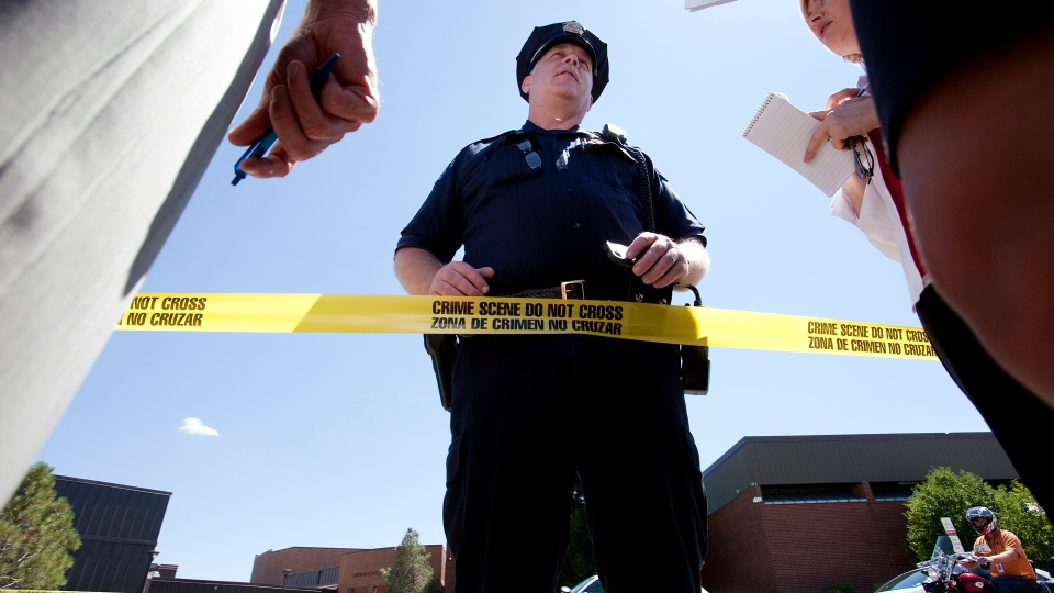 Lt. H.D. Gidden speaks briefly to the media outside Gateway High School where witnesses were brought for questioning after a gunman opened fire at the midnight premiere of 'The Dark Knight Rises' in Aurora, Colo., Friday, July 20, 2012 (AP / Barry Gutierrez)