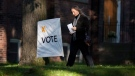 A woman makes her way to a voting station in Toronto as voters cast their ballots in the Ontario Provincial Election on Thursday October 6, 2011. THE CANADIAN PRESS/Chris Young.