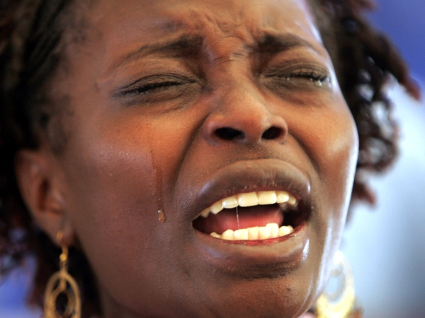 A Kenyan woman cries during a prayer for peace at a church in Nairobi, Kenya, Sunday, Jan. 6, 2008. (AP Photo / Karel Prinsloo)
