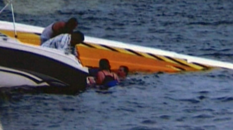 Other boaters came to the rescue of a father and son after their speedboat flipped on Lake Simcoe on Sunday, Aug. 1, 2010. (Denise Carl/Special to CTV News)