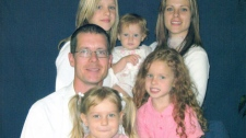 Pilot Brian Tilley, who was killed in a crash on July 31, 2010, is seen with his family in this undated photo. (CTV)