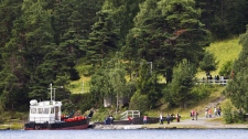 Family and friends of the Utoya Island victims visit the island on July 22, 2012.