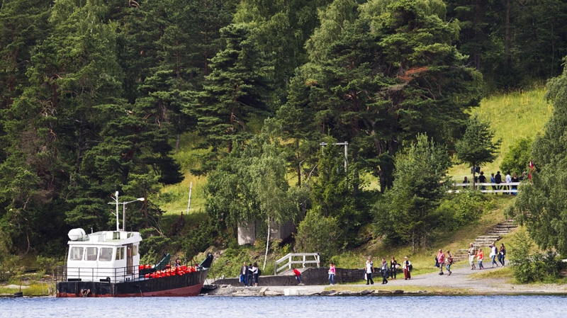 Bereaved families and friends of the 69 people who were gunned down and killed at Utoya Island in the Tyrifjord a year ago, are ferried across to the island on the first anniversary of the massacre, Norway, Sunday, July 22, 2012. (AP Photo/Vegard Groett / NTB scanpix)
