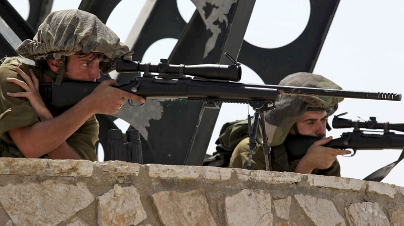 Israeli soldiers look through the sights of their weapons from a position in northern Israel overlooking the Israeli-Lebanese border, Tuesday, Aug. 3, 2010. Lebanese and Israeli troops exchanged fire on the border Tuesday in the most serious clashes since a fierce war four years ago. (AP / Yaron Kaminsky)