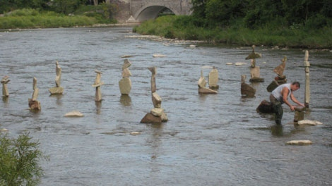 MyNews contributor Richard Smith submitted this photo of Peter Riedel balancing rocks in the Humber River on Sunday, Aug. 2, 2010. (Richard Smith / MyNews.CTV.ca)