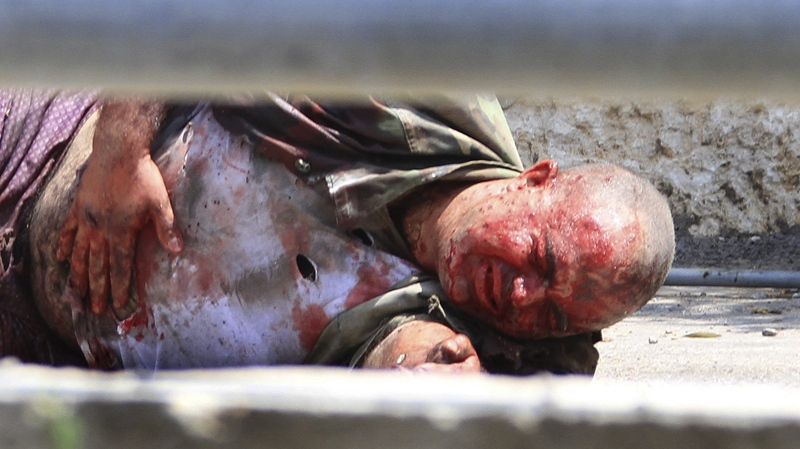 A Lebanese soldier lies injured on the ground in the southern border village of Adaisseh, Lebanon, Tuesday, Aug. 3, 2010. (AP / Mohammed Zaatari)