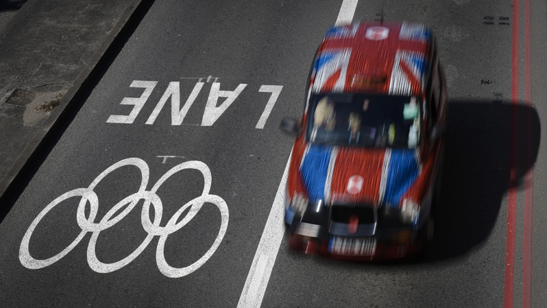 A taxi passes alongside one of the official Olympic Lanes on a street in central London Monday, July 23, 2012, ahead of the 2012 Summer Olympics. (AP / Ben Curtis)