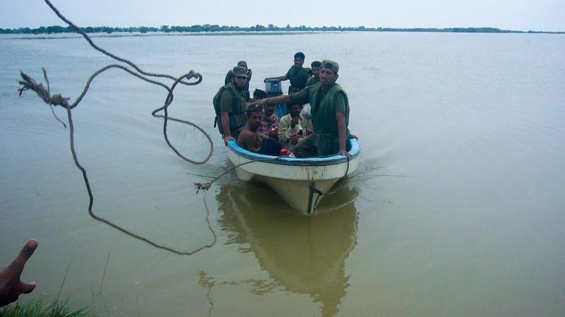 Pakistan army soldiers rescue stranded villagers in Dera Ghazi Khan on Tuesday, Aug. 3, 2010. (AP / Shiekh Saleem Raza)