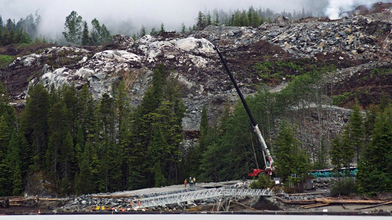 Heavy equipment can be seen working on the Kitimat Liquified Natural Gas project at Bish Cove, Douglas Channel, south of Kitimat, BC., on Wednesday, June 27, 2012.  (Robin Rowland / THE CANADIAN PRESS)