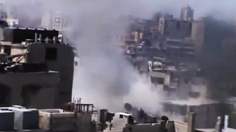 In this image made from amateur video released by the Ugarit News and accessed Monday, July 23, 2012, smoke rises from buildings in Homs, Syria. (AP /Ugarit News via AP video)