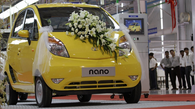 A decorated Tata Nano stands before being rolled out during the inauguration of the Nano plant in Sanand, about 40 kilometers (25 miles) from Ahmadabad, India, Wednesday, June 2, 2010. (AP Photo/Ajit Solanki)