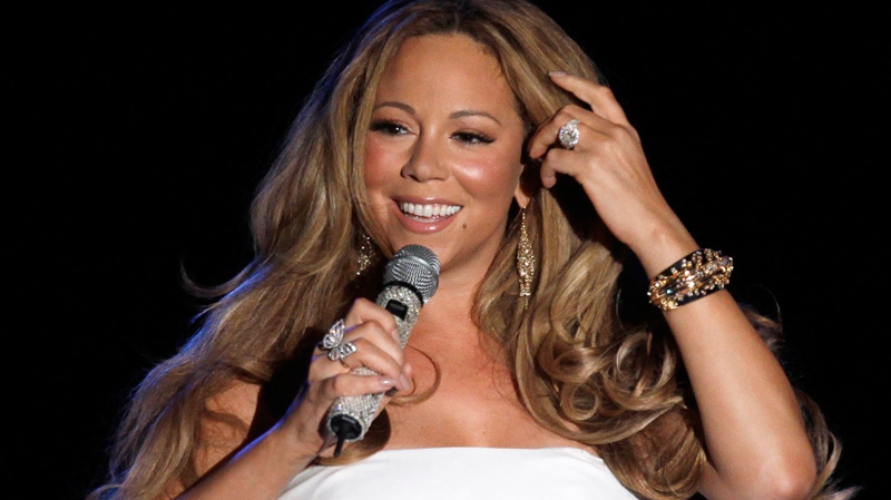 Singer Mariah Carey performs during a concert in Monaco on June 2, 2012. (AP /Lionel Cironneau)