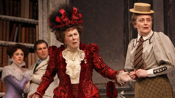 In this publicity image released by Stratford Shakespeare Festival, cast, from left, Sara Topham as Gwendolen Fairfax, Ben Carlson as John Worthing, Brian Bedford as Lady Bracknell and Sarah Dodd as Miss Prism are shown in a scene from the Stratford Shakespeare Festival production of, 'The Importance of Being Earnest.'