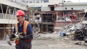 A worker walks back from the rubble at the Algo Centre Mall in Elliot Lake, Ont., on June 27, 2012. (Nathan Denette / THE CANADIAN PRESS)