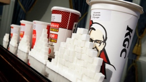 A display of various size cups and sugar cubes is seen at a news conference at New York's City Hall on Thursday, May 31, 2012. (AP / Richard Drew)