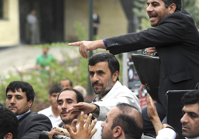 Iranian President Mahmoud Ahmadinejad, centre, is surrounded by bodyguards as he arrives to address a public gathering,i n Hamedan about 340 kilometres southwest of the capital Tehran, Iran, Wednesday, Aug. 4, 2010. (ISNA / Saman Aghvami)