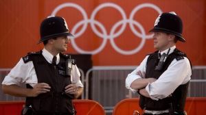 Police officers stand guard inside the Olympic Park in London, Monday, July 23, 2012. (AP / Emilio Morenatti)