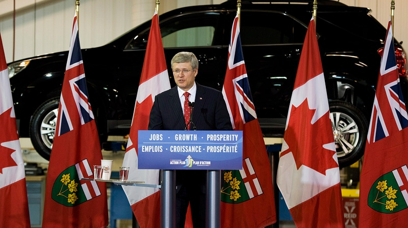 Prime Minister Stephen Harper speaks at the General Motors Plant in Oshawa, Ontario on Tuesday July 24, 2012. (Aaron Vincent Elkaim / THE CANADIAN PRESS)