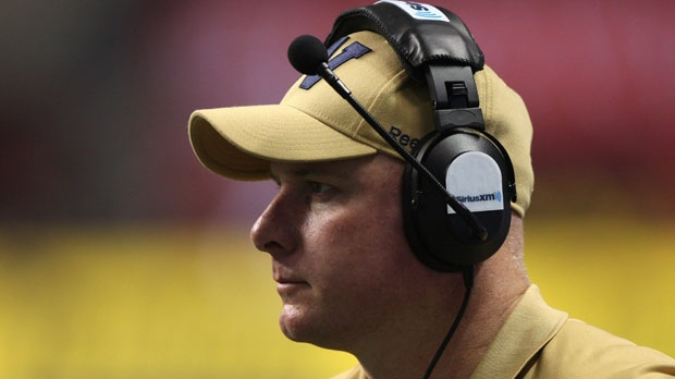 Winnipeg Blue Bombers head coach Paul LaPolice watches his charges from the sideline during second quarter of the 99th CFL Grey Cup on Sunday November 27, 2011 in Vancouver. (The Canadian Press/Ryan Remiorz)