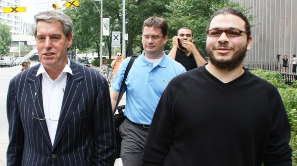 Abdullah Khadr (right) walks with his lawyers Dennis Edney (left) and Nate Whitling (centre) outside court in Toronto, Wednesday, Aug.4, 2010. (Colin Perkel / THE CANADIAN PRESS)