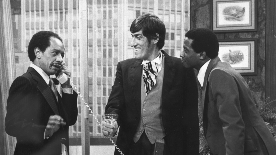 In this 1977 photo provided by CBS, from left, Sherman Hemsley, Paul Benedict, and Damon Evans star in an episode of 'The Jeffersons.'