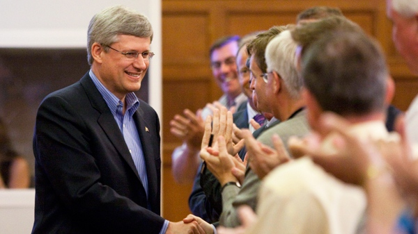 Prime Minister Stephen Harper shakes hands with party members as he arrives to take part in the Conservative summer caucus on Parliament Hill in Ottawa on Thursday Aug. 5, 2010. (Sean Kilpatrick / THE CANADIAN PRESS)