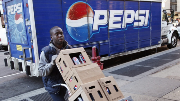 Kandral McKenzie delivers Pepsi products on Feb. 9, 2012 in New York.