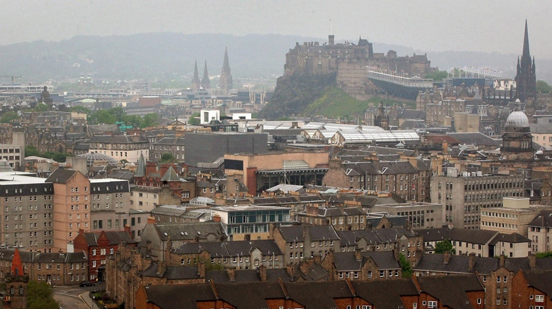 A general view of the city of Edinburgh, with Edinburgh Castle in the background. (AP / David Cheskin / PA Wire)