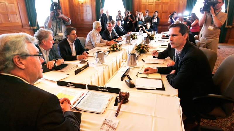 Ontario Premier Dalton McGuinty talks with Manitoba Premier Greg Selinger at the opening meeting of the Premiers' annual meeting in Winnipeg, Thursday, August 5, 2010. (John Woods / THE CANADIAN PRESS)