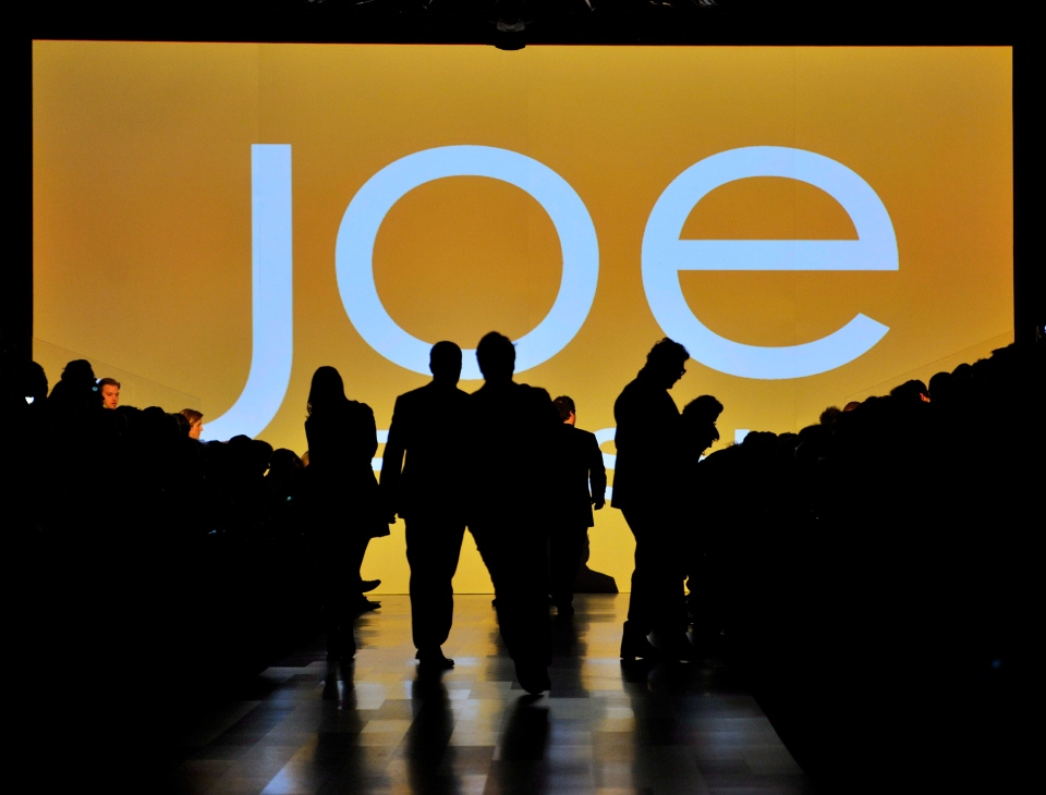 People take their seats on the runway for the Joe Fresh collection during the 2012 Toronto Fashion Week in Toronto on Wednesday, March 14, 2012. (Nathan Denette / THE CANADIAN PRESS)