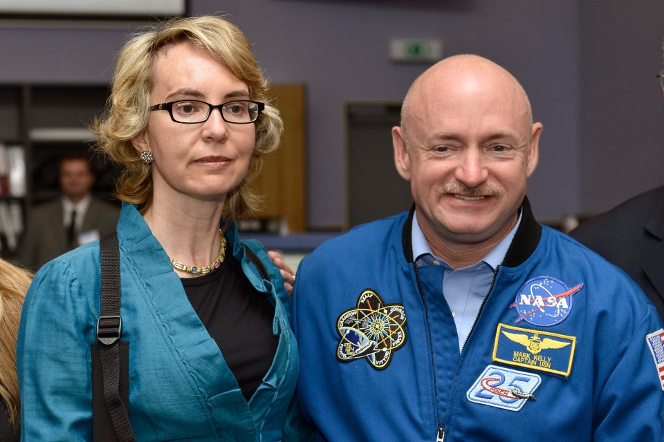 Former U.S. Congresswoman Gabrielle Giffords, left, and her husband Mark Kelly, right, NASA astronaut and commander of mission STS-134, pose for a picture at the Alpha Magnetic Spectrometer (AMS) Payload Operations and Command Center (POCC) at the European Organization for Nuclear Research (CERN) in Meyrin near Geneva, Switzerland, Wednesday, July 25, 2012. (AP / Keystone / Martial Trezzini)