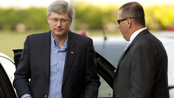 Prime Minister Stephen Harper arrives to Parliament Hill to take part in the Conservative summer caucus in Ottawa on Thursday, Aug. 5, 2010. (Sean Kilpatrick / THE CANADIAN PRESS)