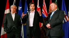 New Brunswick Premier Shawn Graham speaks at a press conference as Manitoba Premier Greg Selinger (left) and Nova Scotia Premier Darrell Dexter listen in at the annual Premiers Conference in Winnipeg, Thursday, August 5, 2010. (John Woods / THE CANADIAN PRESS)