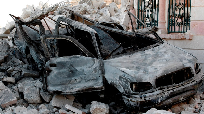 A damaged vehicle from clashes between Free Syrian Army soldiers and Syrian government troops is seen at the border town of Azaz, some 32 kilometres north of Aleppo, Syria on Tuesday, July 24, 2012. (AP / Turkpix)