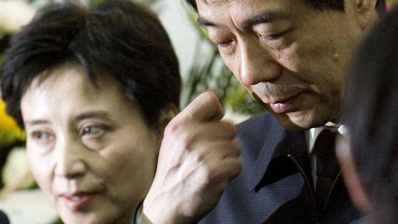 In this Jan. 17, 2007 file photo, former Chongqing Communist Party Secretary Bo Xilai, right, accompanied by his wife Gu Kailai, attends a funeral for his father in Beijing. (AP / Kyodo News / China Foto Press)