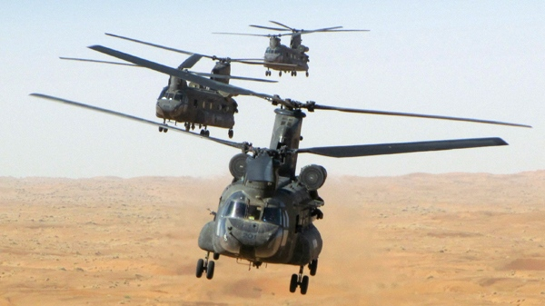 Canadian Forces Chinook helicopters fly in formation during a training mission in Afghanistan. (Master Cpl. Craig Wiggins / Department of National Defence)