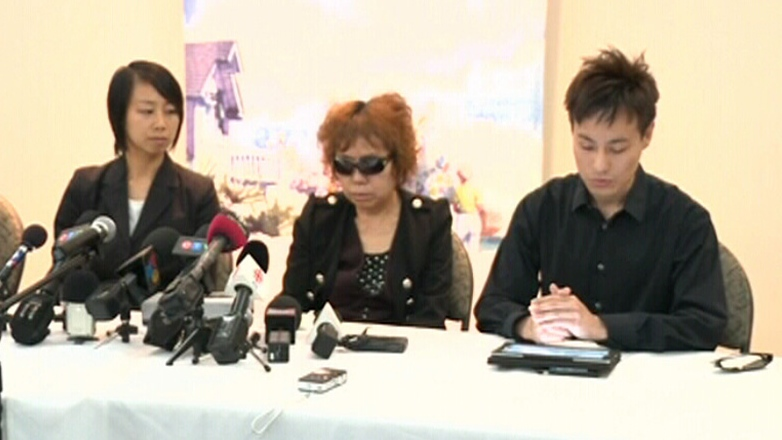 The family of Lin Jun speaks to the media in Montreal, Thursday, July 26, 2012.