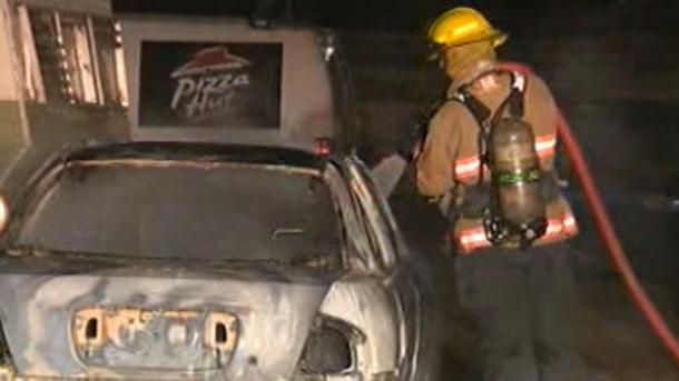 Fire crews extinguish a North Point Douglas car fire.
