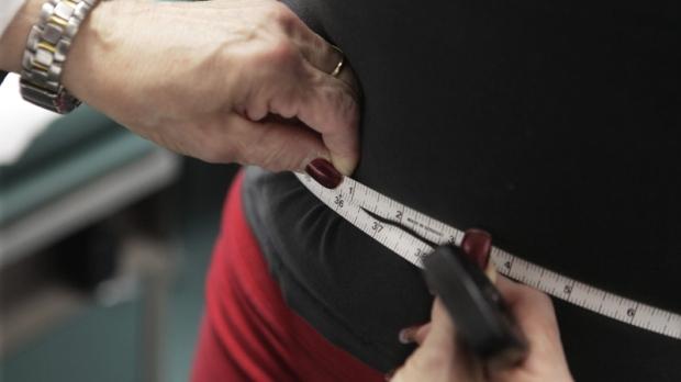 Paris Woods has her waist measured