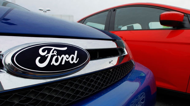 The Ford logo is seen on cars for sale at a Ford dealership in Springfield, Ill., July 1, 2012. (AP / Seth Perlman)