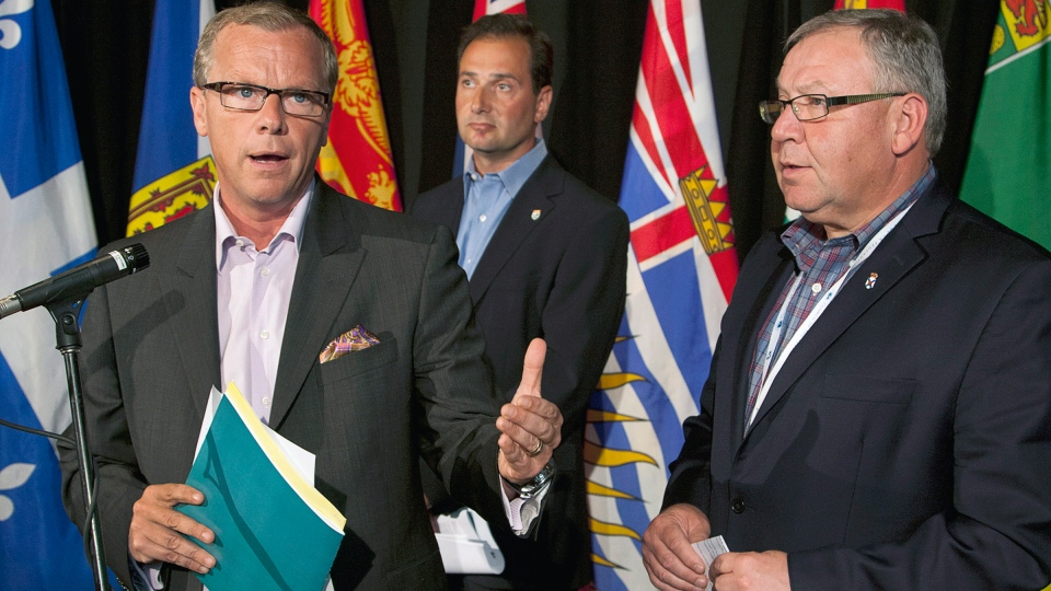 Saskatchewan Premier Brad Wall, Prince Edward Island Premier Robert Ghiz and Nova Scotia Premier Darrell Dexter, left to right, field questions at the annual Council of the Federation meeting in Halifax on Thursday, July 26, 2012. (Andrew Vaughan / THE CANADIAN PRESS)
