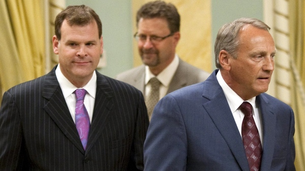 John Baird arrives to be sworn in as government house leader, left to right, with Chuck Strahl to be sworn in as minister of transport, infrastructure and Communities along with and Conservative MP for Vancouver Island North John Duncan as minister of Indian Affairs and northern development and federal interlocutor for Metis and non-status Indians during a cabinet shuffle at Rideau Hall in Ottawa on Friday, Aug. 6, 2010. (Sean Kilpatrick / THE CANADIAN PRESS)