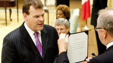 John Baird is sworn in as government house leader as Prime Minister Stephen Harper and Gov. Gen. Michaelle Jean look on during a cabinet shuffle at Rideau Hall in Ottawa on Friday, Aug. 6, 2010. (Sean Kilpatrick / THE CANADIAN PRESS)