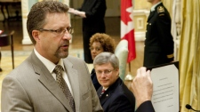 Chuck Strahl is sworn in as minister of transport, infrastructure and communities as Prime Minister Stephen Harper and Gov. Gen. Michaelle Jean look on during a cabinet shuffle at Rideau Hall in Ottawa on Friday, Aug. 6, 2010. (Sean Kilpatrick / THE CANADIAN PRESS)