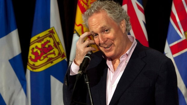 Quebec Premier Jean Charest fields a question at the annual Council of the Federation meeting