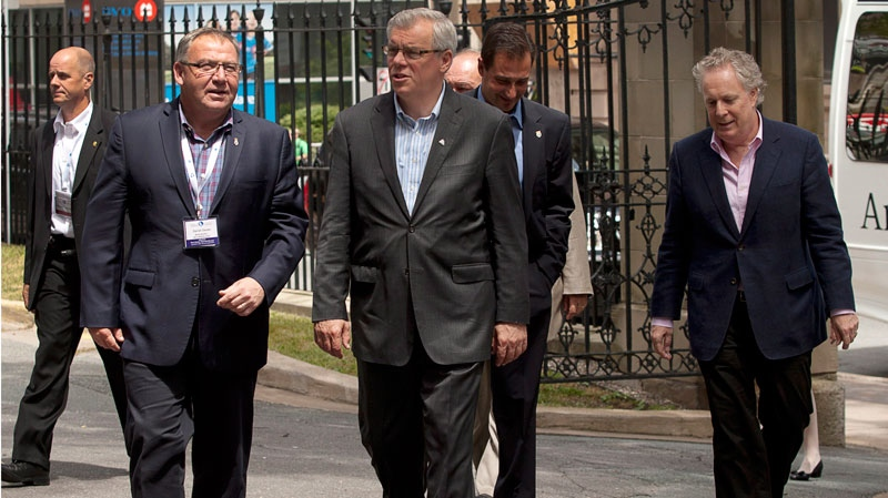 Nova Scotia Premier Darrell Dexter, Manitoba Premier Greg Selinger, Prince Edward Island Premier Robert Ghiz and Quebec Premier Jean Charest head for lunch at Province House at the annual Council of the Federation meeting in Halifax on Thursday, July 26, 2012. (Andrew Vaughan / THE CANADIAN PRESS)